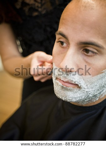 Shaving situation at the hair salon close-up - stock photo