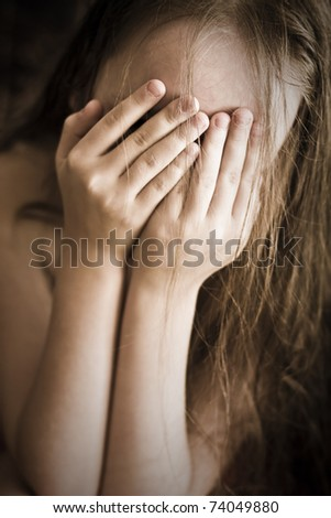 She closed the hands of a person - stock photo