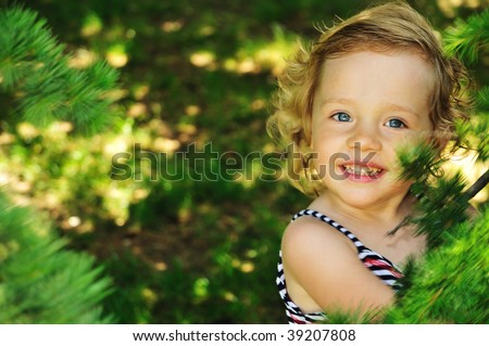 she is cute, smiling blond girl, she is happy to be in forest - stock photo
