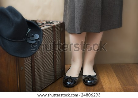 she is going to traveling with her bag and black hat - stock photo