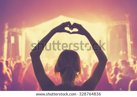 She loves this  band! - stock photo