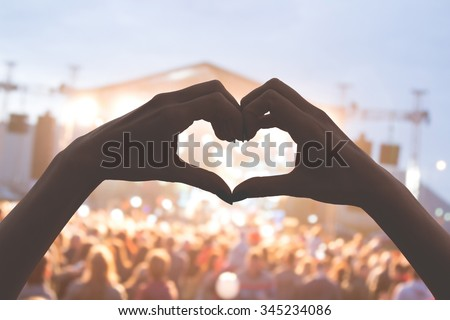 She loves this band! Heart shape for the music. - stock photo