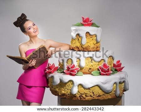 She prepared a huge cake - stock photo