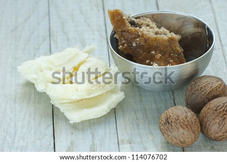 shea butter natural moisturizer and african black soap in bowl - stock photo