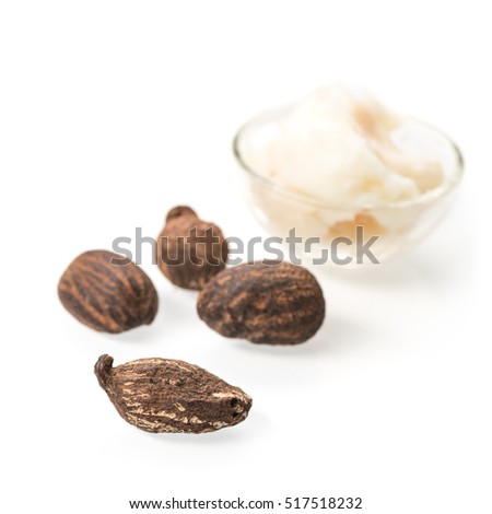 Shea butter nuts and a cup of she butter