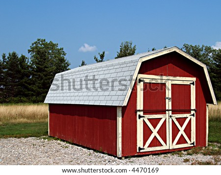 Shed made to look like a small red barn on a farm - stock photo