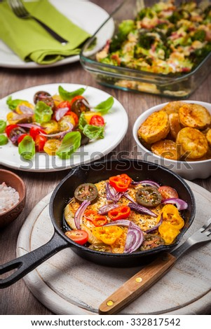 Sheep's grilled cheese with salad and oven backed potatoes - stock photo