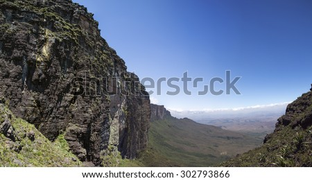 Sheer cliffs of Mount Roraima - landscape with blue sky and clouds background. View on the Gran Sabana and Mount Roraima. Venezuela 2015. - stock photo