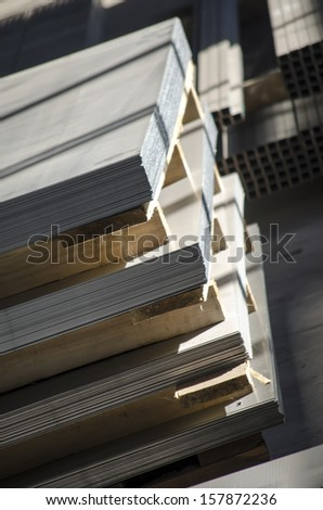 sheet metal on wooden palettes - stock photo