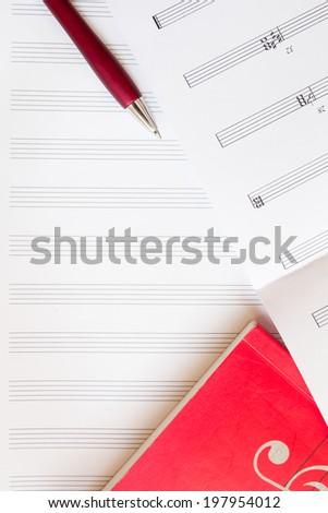 Sheet music with pen and music book, for copy writing space - stock photo