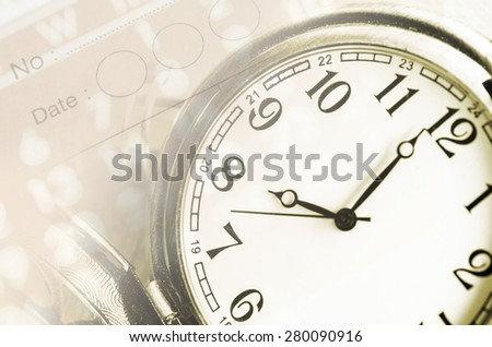 sheet of a calendar and diary with the number of days and clock close-up - stock photo