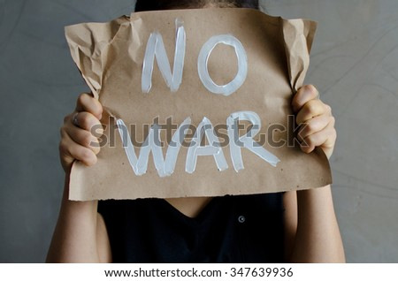 sheet of craft paper with white color inscription no war - stock photo