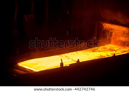 Sheet of hot metal on the conveyor belt