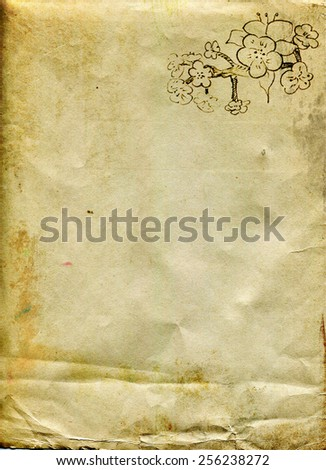 Sheet of old paper with a sketch of branches of fruit flowers in the corner - stock photo