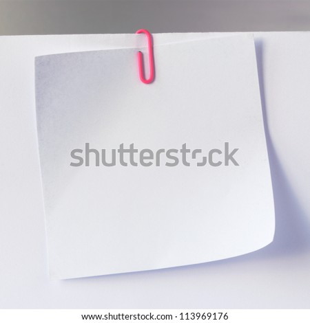 sheet of paper for notes and paper clip