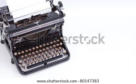 Sheet of paper inserted into teh vintage typewriter - stock photo