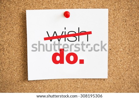 Sheet of paper on a cork pinboard with red plastic pin with motivated words. Selective focus  - stock photo