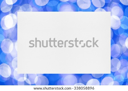 Sheet of paper on holiday lights background - stock photo