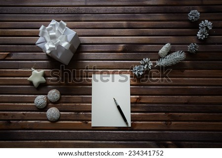Sheet of paper on table among xmas things - stock photo
