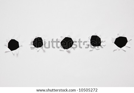 sheet of paper with row of holes