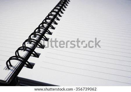 Sheet of ruled notebook paper with a spiral binding