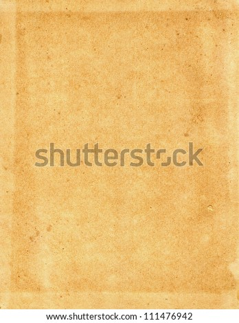 Sheet of the old, coarse yellow paper, cardboard - stock photo