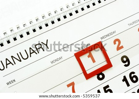 Sheet of wall calendar with red mark on 1-st January - stock photo