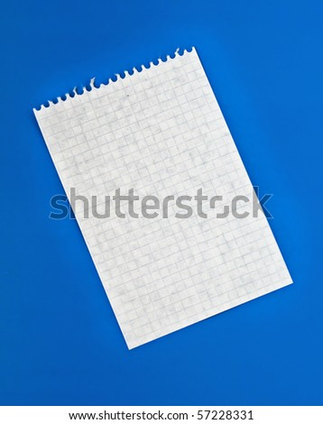 Sheet of white lined paper on the blue background - stock photo