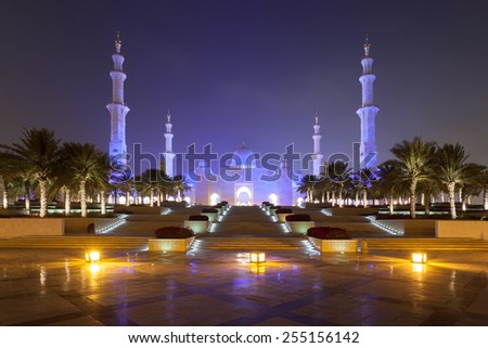 Sheikh Zayed Mosque in Abu Dhabi illuminated at night - stock photo