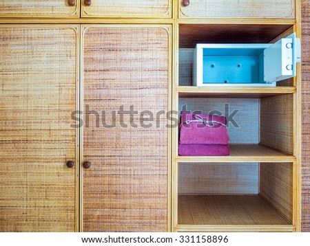 shelf decorated with woven texture of bamboo background - stock photo