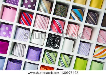 Shelf full of fine silk neckties on a Chinese street market - stock photo