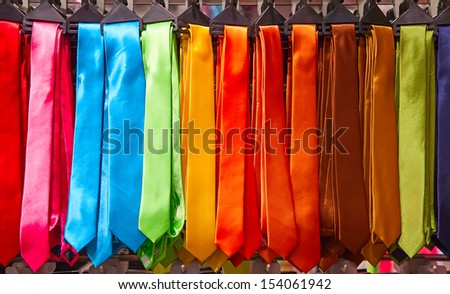 Shelf full of fine silk neckties on a Chinese street market - stock photo