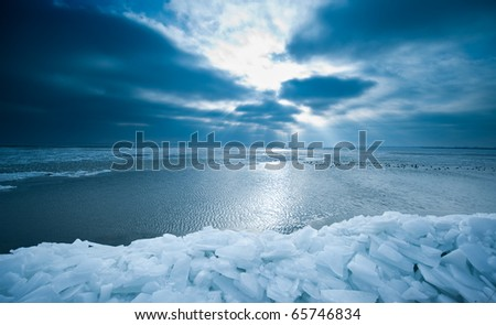 shelf ice and sunset in Marken a small village near Amsterdam The Netherlands - stock photo
