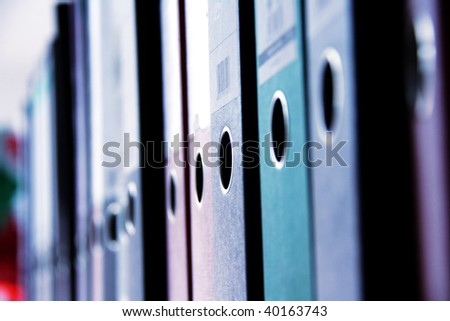 shelf in a office with many files - stock photo
