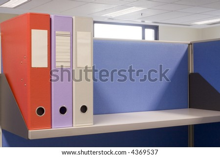Shelf in an office cubicle with some files - stock photo