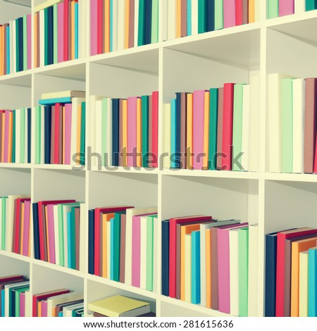 shelf of books in the library, toned photo - stock photo