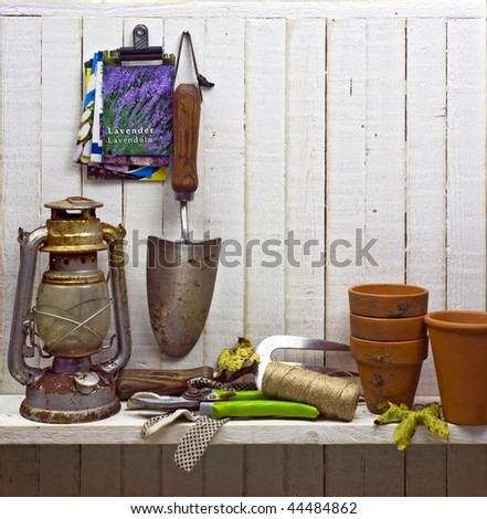 shelf of junk and gardening implements in shed; good copy-space - stock photo