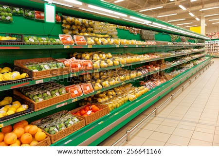 Shelf with citrus fruits, TMs removed, price tags left in place and contain no copyright - stock photo