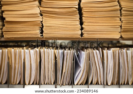 Shelf with file folders in a archives - stock photo