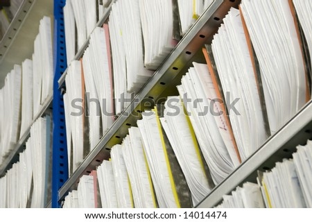 Shelf with Folders for documents - stock photo