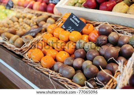 Shelf with fruits on a farm market - stock photo