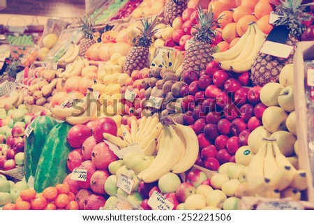 Shelf with fruits on a farm market, toned image - stock photo