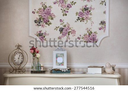 Shelf with home decor in the style of provence - stock photo