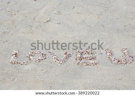 shell alphabets love you  on sand beach - stock photo