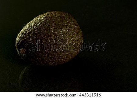 Shell texture of avocado with Dew Covered in low key and dark background