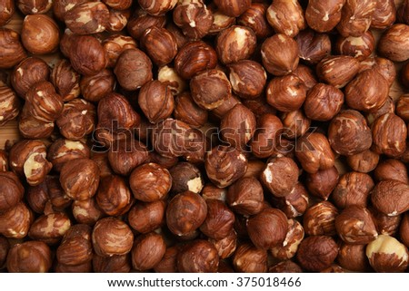 Shelled hazelnuts shot from a high angle view - stock photo