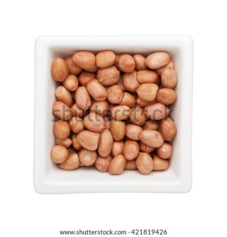 Shelled peanuts in a square bowl isolated on white background - stock photo