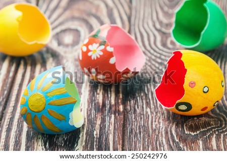 shells of easter eggs on a wooden table - stock photo
