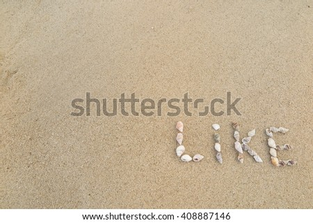 "shells on the sand in the written words ""Like"""