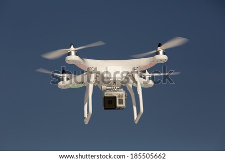SHELTON, CT , U.S. - DECEMBER19: Editorial photo of a DJI Phantom drone in flight with a mounted GoPro Hero3+ Black Edition digital camera on December 19, 2013 in Shelton, Ct.   - stock photo